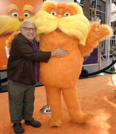 "Actor Danny DeVito and The Lorax arrive at the premiere of the animated feature film ""The Lorax"""